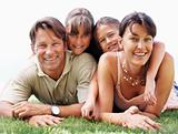 Smiling family lying on grass