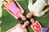 Attractive family lying on grass