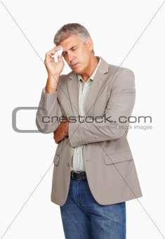 Business man expressing headache