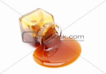 Honey spill from a glass jar