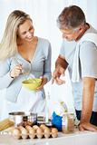 Mature couple preparing batter