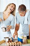Couple enjoying together in kitchen