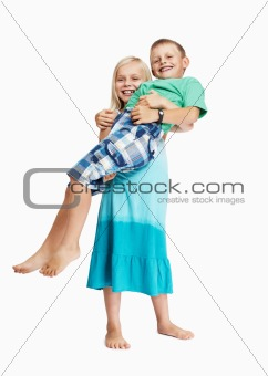 Young girl carrying boy on white background