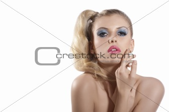 Blond girl with creative make up posing and looking towards the
