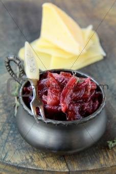 french cuisine - onion confiture on wooden table