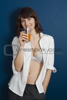 Beautiful woman drinking orange juice