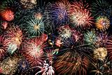 Multicolored fireworks fill the frame