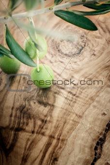 Olive branch on olive wood background