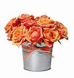 Bouquet of orange roses in the pot