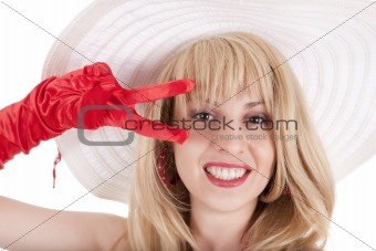 Playful fashion girl in retro style with big hat