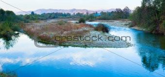 Blue river panorama and autumn evening mountain