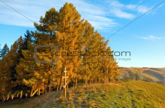 Autumn morning mountain and wooden cross