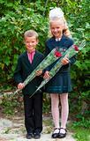 Portrait of nice little schoolgirl and schoolboy