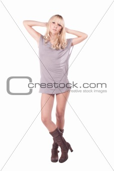 A girl in a gray dress. Blonde.