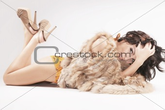Beautiful woman lying on white background