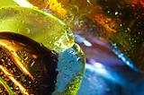 Bright colorful abstract background. Glass and drops of water.