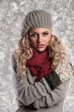 wonderful blonde girl in woolen winter clothes