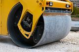 Roller tamping gravel