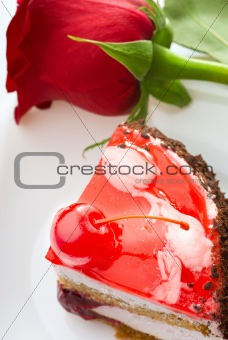 A piece of cake and a red rose