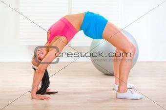 Fitness girl doing bridge exercise at home