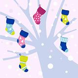 Christmas socks on winter tree, snowing behind - vector
