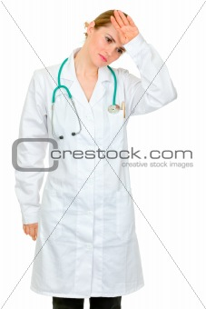 Tired medical doctor woman