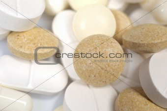 Group of medical pills and vitamins. can be used as background