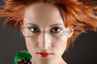 Beauty portrait of pretty woman with healthy red flying hair