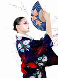 japan geisha woman with creative make-up dancing with fan
