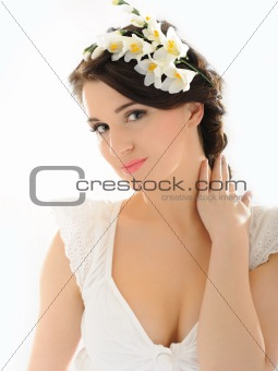 Beautiful fresh spring woman with flowers in her hair