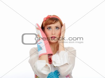 Beautiful cooking woman in apron and kitchen glove in panic.