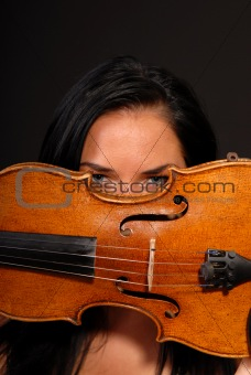 beautiful woman playing the violin