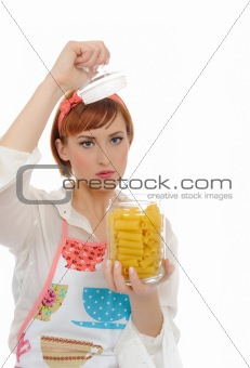 Beautiful cooking woman in apron with italian pasta. isolated