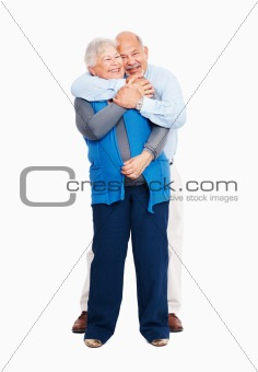 Business couple embracing on white background