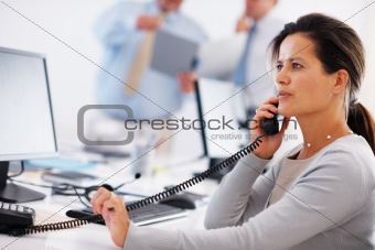 Business woman discussing over telephone