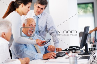 Business people calculating finance