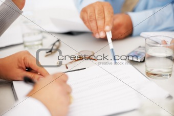 Business people busy with paperwork