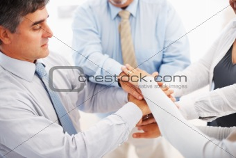 Unity - Business colleagues with their hands together