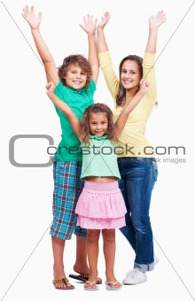 Joyful children raising hands together on white background
