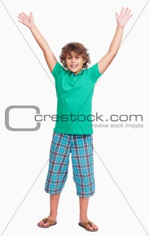 Cute little boy raising hands isolated on white background