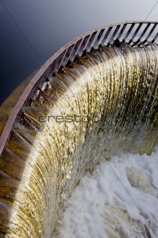 Water runs through dam.