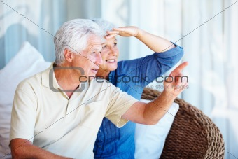 Senior man showing something to woman