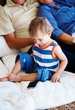 Young kid looking at mobile phone