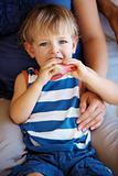 Little kid eating watermelon