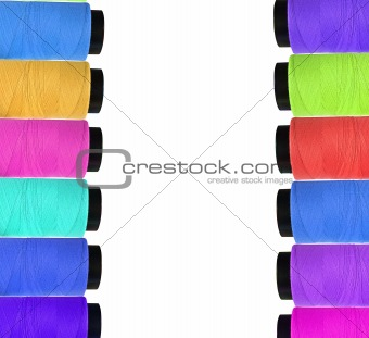 Many multicolor bobbins isolated on white background