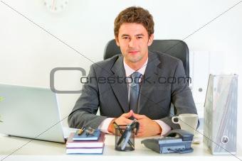 Portrait of happy modern businessman in office