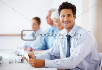 Confident business man attending a meeting