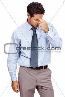 Businessman looking tired and depressed from work