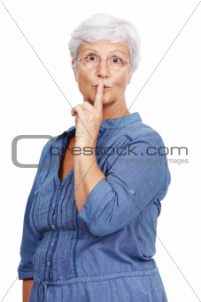 Portrait of a senior woman indicating keep silence