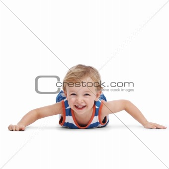 Cute little boy lying on floor and smiling
